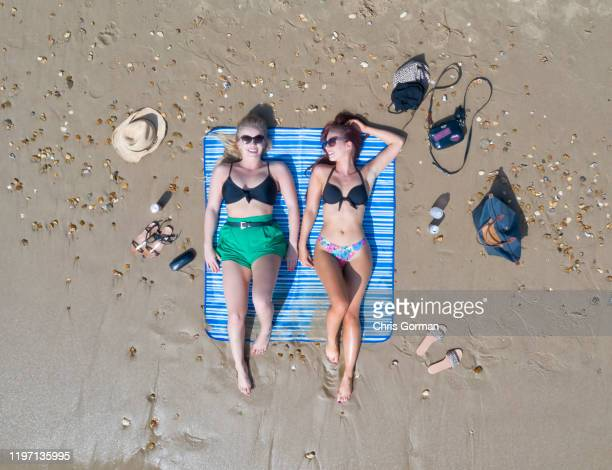 Alex Woolley and Meghan Young, both 22 of Cirencester, enjoy the hot weather on Bournemouth beach on April 19, 2019 in Bournemouth, United Kingdom.