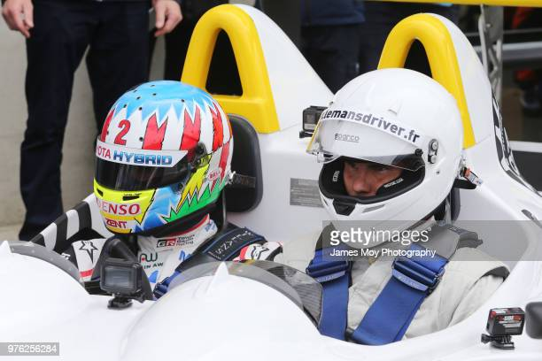 Alex Wurz of Austria and Toyota Gazoo Racing gives tennis player Rafael Nadal of Spain a guest ride before the start of the Le Mans 24 Hour race on...