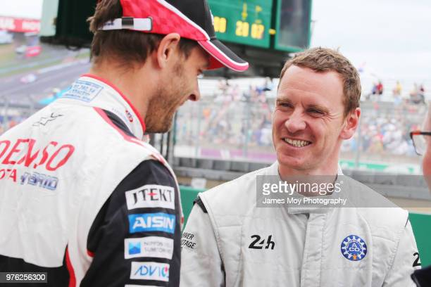 Alex Wurz of Austria and Toyota Gazoo Racing with actor Michael Fassbender of Ireland on the grid before the start of the Le Mans 24 Hour race on...