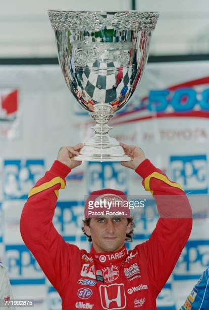 Alex Zanardi of Italy and driver of the Target Chip Ganassi Racing Reynard 97i Honda lifts the The Vanderbilt Cup designed and produced by Tiffany...