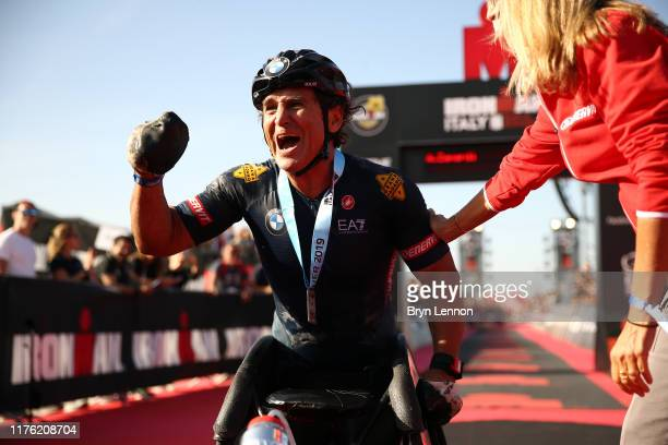 Alex Zanardi of Italy celebrates finishing IRONMAN Italy on September 21 2019 in Cervia Italy