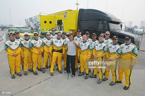 Alex Zanardi stands with the Simple Green Safety Team on July 6 2002 that helped him survive his accident at the American Memorial race in Germany in...