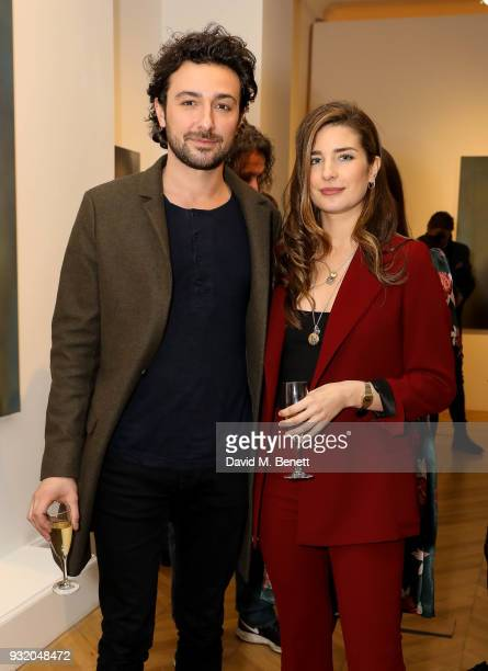Alex Zane and Nettie Wakefield attend the private view and wine tasting event of Miaz Brothers Anonymous at Lazinc on March 14 2018 in London England