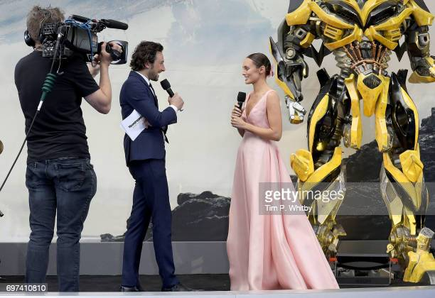 Alex Zane interviews Laura Haddock on stage at the global premiere of 'Transformers The Last Knight' at Cineworld Leicester Square on June 18 2017 in...