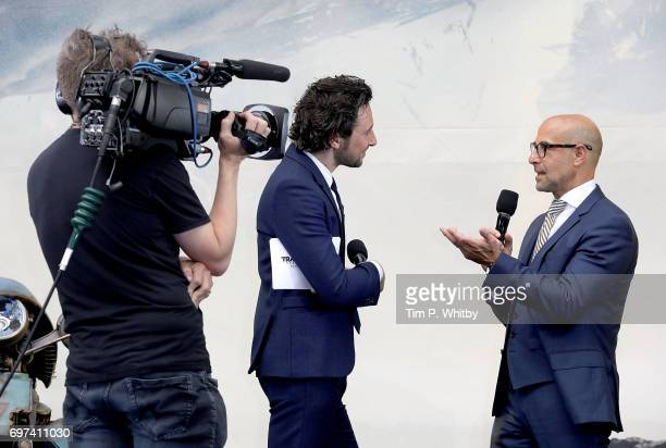 Alex Zane interviews Stanley Tucci on stage at the global premiere of 'Transformers The Last Knight' at Cineworld Leicester Square on June 18 2017 in...