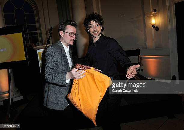 Alex Zane presents prizes during a social media party to launch the 'FDA Summer 2013 At The Cinema' at Somerset House on April 23 2013 in London...