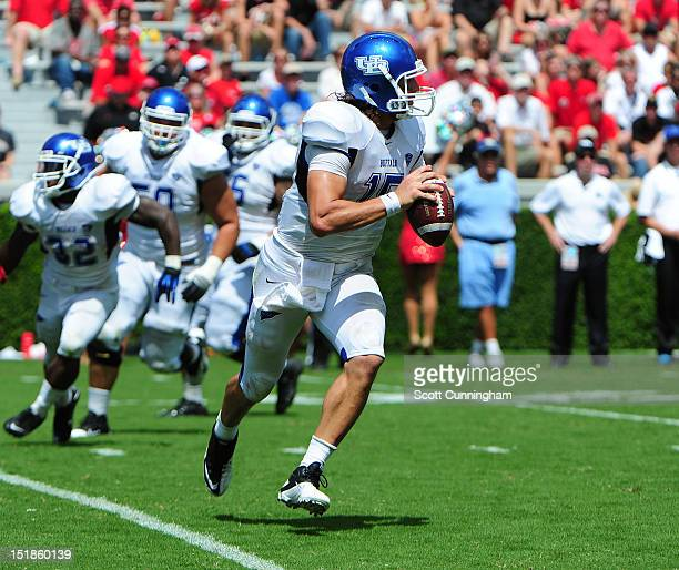 Alex Zordich of the Buffalo Bulls rolls out to pass against the Georgia Bulldogs at Sanford Stadium on September 1 2012 in Athens Georgia
