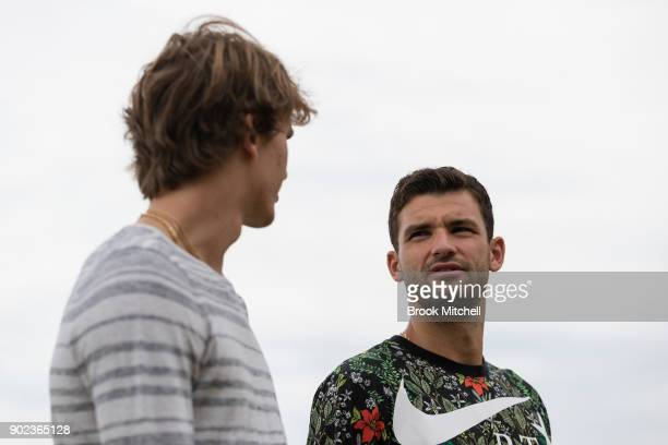 Alex Zverev chats to Grigor Dimitrov during the Sydney Fast4 Media Opportunity at Hickson Road Reserve on January 8 2018 in Sydney Australia