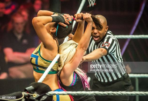 Alexa Bliss and Bayley battle in the ring during the WWE show at Zenith Arena on may 09 2017 in Lille France / AFP PHOTO / PHILIPPE HUGUEN