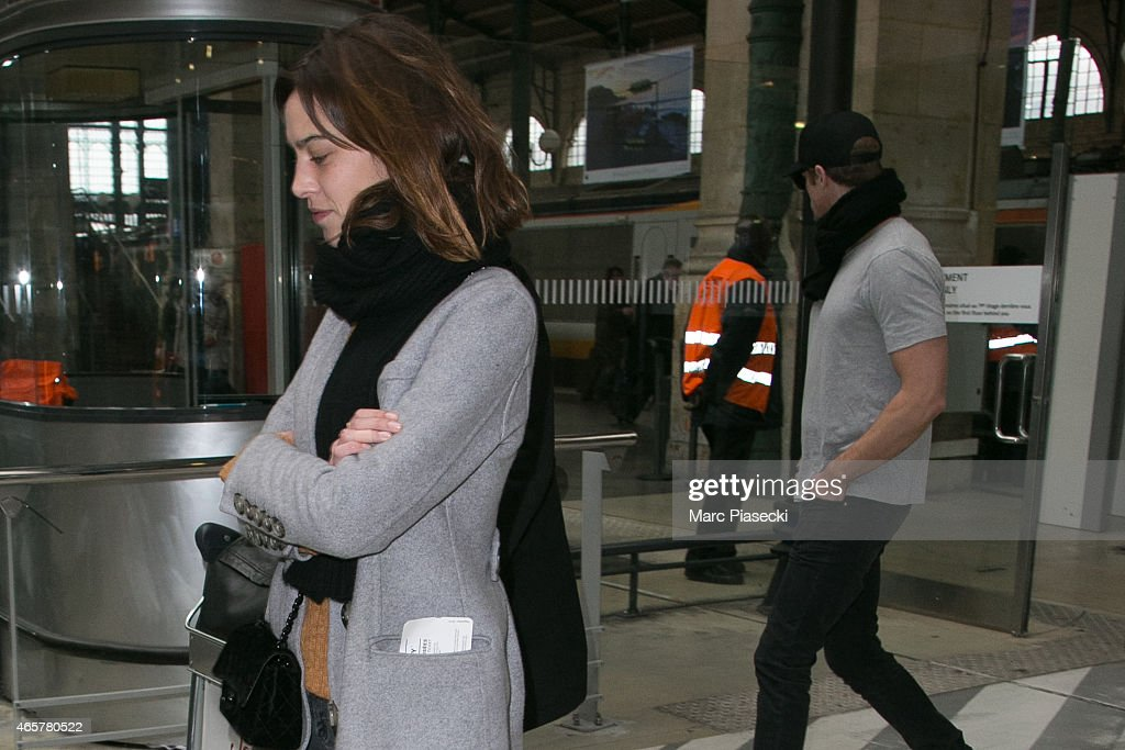 Alexa Chung and Alexander Skarsgard are seen at the 'gare du Nord' station on March 10, 2015 in Paris, France.