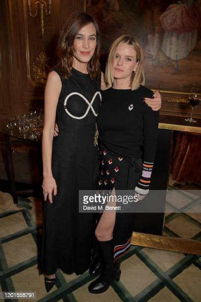 Alexa Chung and Alice Eve attend the Fashion Our Future launch event at Claridge's Hotel on February 17 2020 in London England #FASHIONOURFUTURE is a...