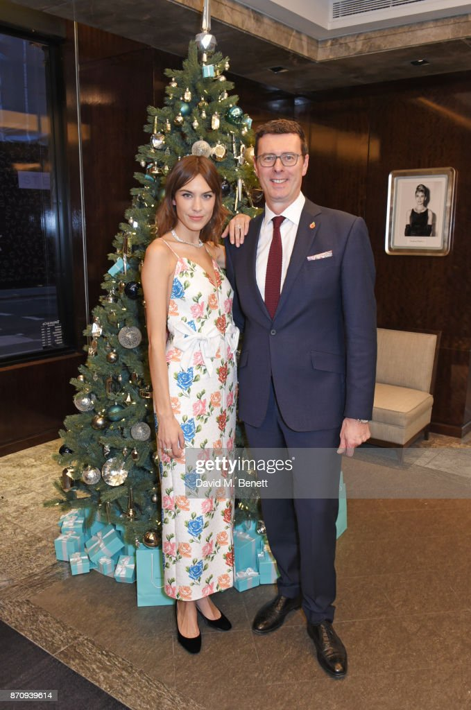 Alexa Chung (L) and Barratt West, Managing Director at Tiffany & Co. pose outside the Tiffany & Co. Old Bond Street Store as she unveils the Tiffany Christmas windows at Tiffany & Co on November 6, 2017 in London, England.