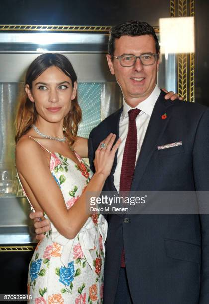 Alexa Chung and Barratt West Managing Director at Tiffany Co pose outside the Tiffany Co Old Bond Street Store as she unveils the Tiffany Christmas...