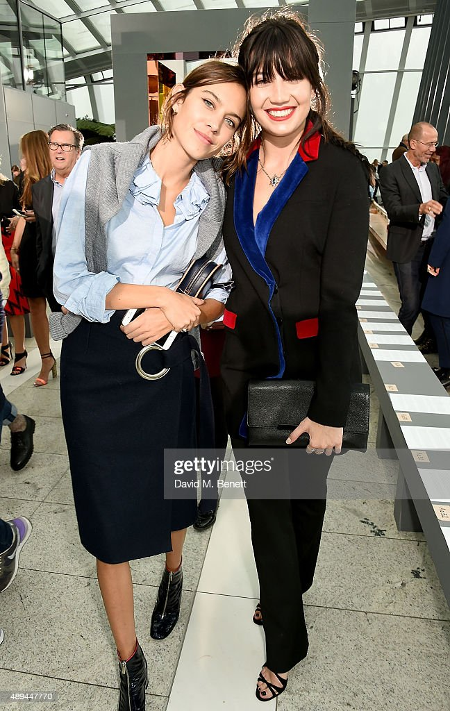 Alexa Chung and Daisy Lowe attend the Christopher Kane show during London Fashion Week SS16 at Sky Garden on September 21, 2015 in London, England.