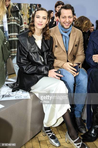 Alexa Chung and Derek Blasberg attend the JW Anderson show during London Fashion Week February 2018 at Yeomanry House on February 17 2018 in London...