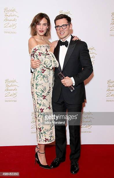 Alexa Chung and Erdem Moralioglu pose in the Winners Room at the British Fashion Awards 2015 at London Coliseum on November 23 2015 in London England