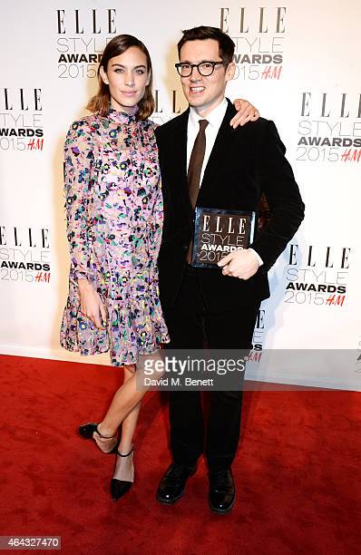 Alexa Chung and Erdem Moralioglu winner of the Designer of the Year award pose in the Winners Room at the Elle Style Awards 2015 at Sky Garden @ The...
