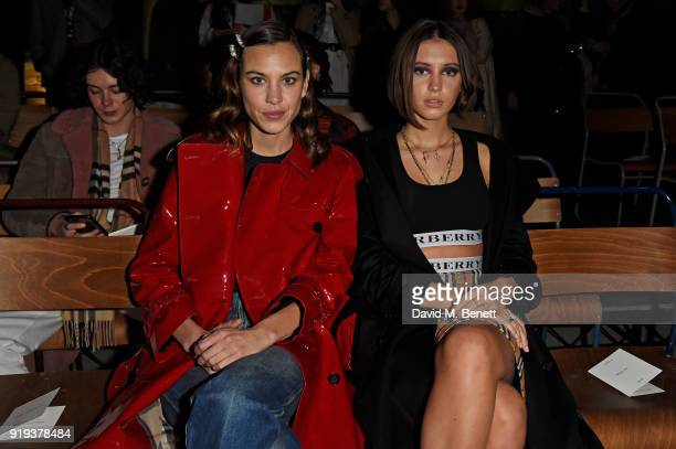 Alexa Chung and Iris Law wearing Burberry at the Burberry February 2018 show during London Fashion Week at Dimco Buildings on February 17 2018 in...