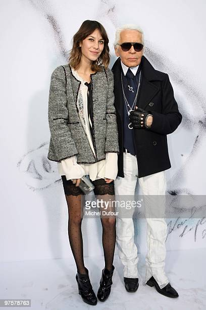 Alexa Chung and Karl Lagerfeld attend the Chanel Ready to Wear show as part of the Paris Womenswear Fashion Week Fall/Winter 2011 at Grand Palais on...