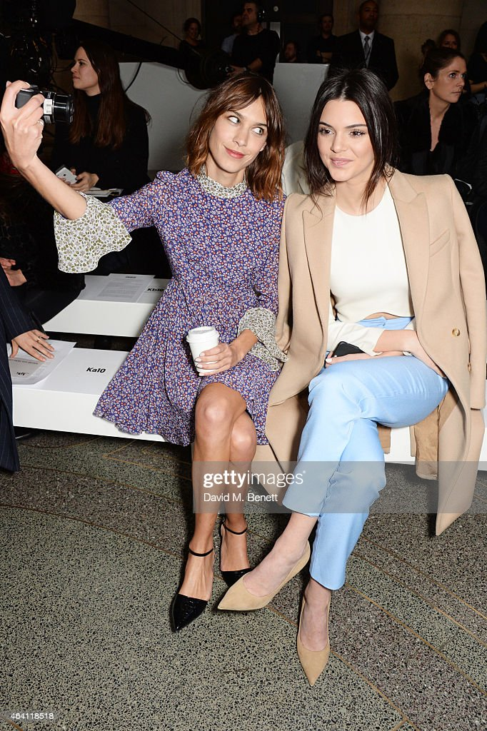 Alexa Chung (L) and Kendall Jenner attend the Topshop Unique show during London Fashion Week Fall/Winter 2015/16 at Tate Britain on February 22, 2015 in London, England.