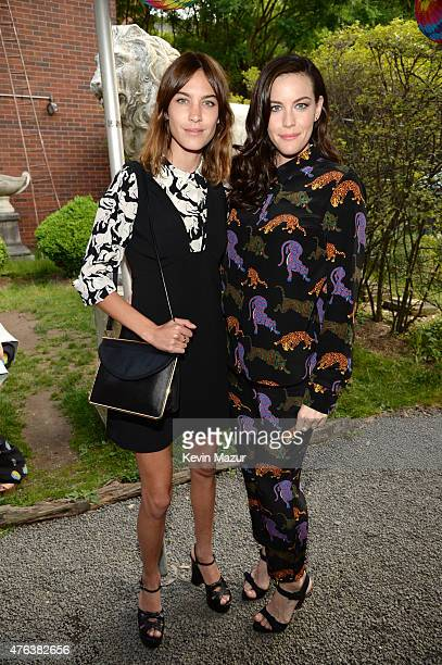 Alexa Chung and Liv Tyler attend the Stella McCartney Spring 2016 Resort Presentation on June 8 2015 in New York City