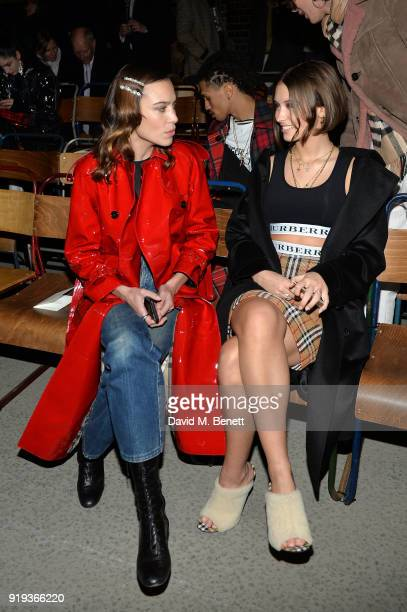 Alexa Chung and Model Iris Law wearing Burberry at the Burberry February 2018 show during London Fashion Week at Dimco Buildings on February 17, 2018...