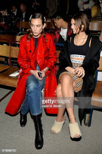 Alexa Chung and Model Iris Law wearing Burberry at the Burberry February 2018 show during London Fashion Week at Dimco Buildings on February 17 2018...