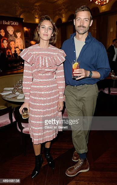 Alexa Chung and Patrick Grant attend the The Business Of Fashion #BoF500 Gala Dinner Party at The London EDITION Hotel on September 21 2015 in London...