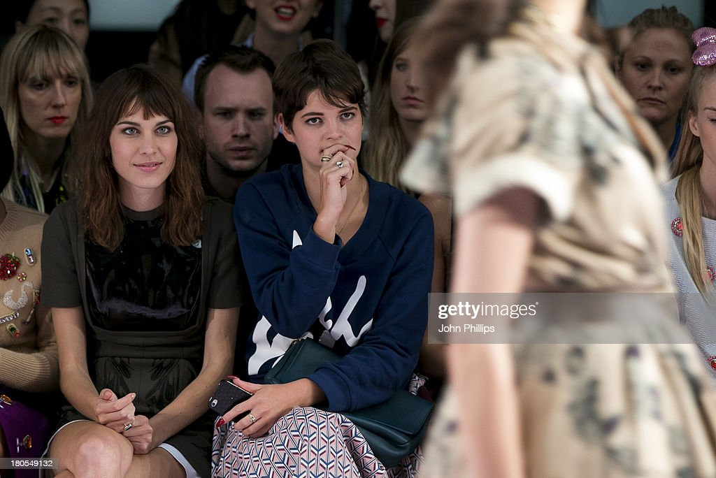 Alexa Chung and Pixie Geldof attend the House Of Holland show during London Fashion Week SS14 on September 14, 2013 in London, England.