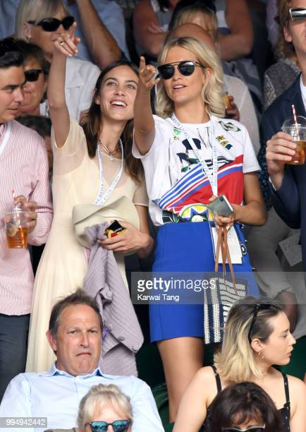 Alexa Chung and Poppy Delevingne attend day seven of the Wimbledon Tennis Championships at the All England Lawn Tennis and Croquet Club on July 9...