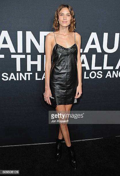 Alexa Chung arrives at SAINT LAURENT At The Palladium at Hollywood Palladium on February 10 2016 in Los Angeles California