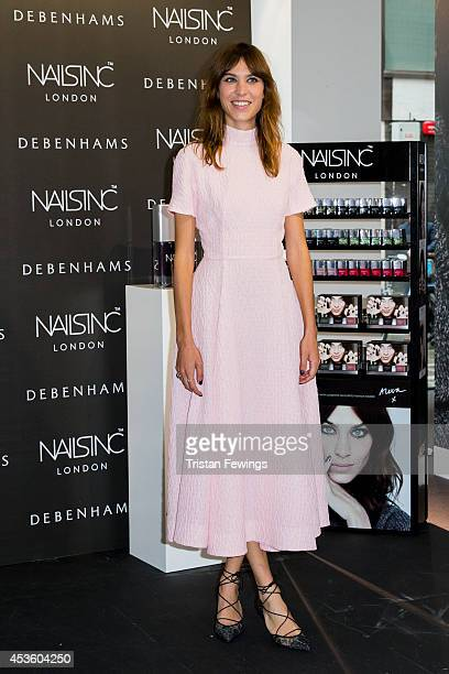 Alexa Chung attends a photocall to launch her Alexa Manicure collection with Nails Inc at Debenhams on August 14 2014 in London England