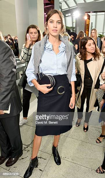 Alexa Chung attends the Christopher Kane show during London Fashion Week SS16 at Sky Garden on September 21 2015 in London England