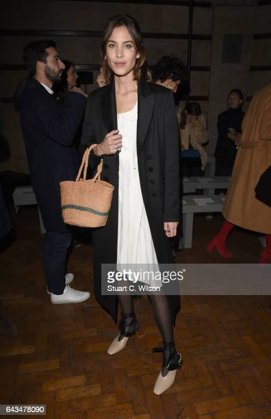 Alexa Chung attends the Emilia Wickstead AW17 catwalk show at The College on February 18 2017 in London England