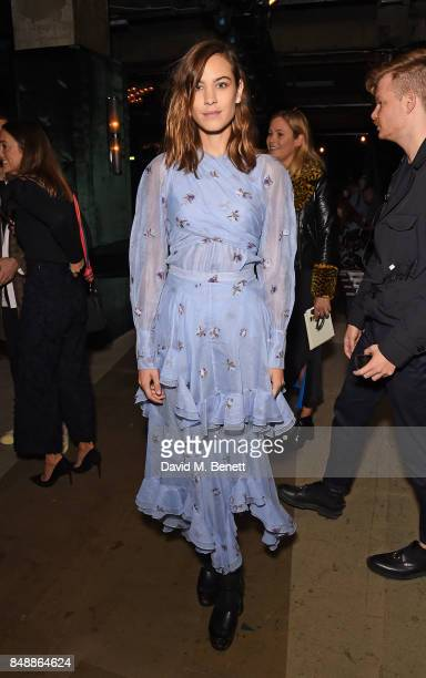 Alexa Chung attends the Erdem catwalk show during London Fashion Week at The Old Selfridges Hotel on September 18 2017 in London England