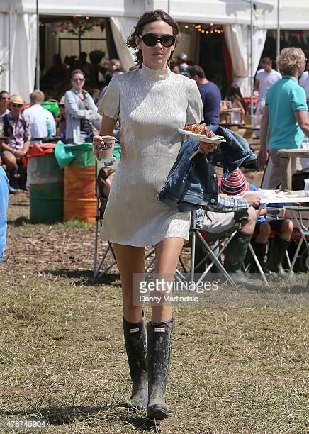 Alexa Chung attends the Glastonbury Festival at Worthy Farm Pilton on June 27 2015 in Glastonbury England