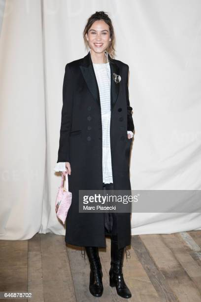 Alexa Chung attends the HM Studio show as part of the Paris Fashion Week on March 1 2017 in Paris France