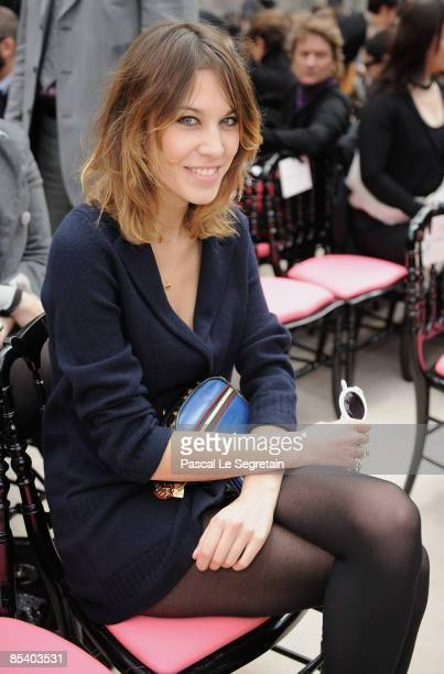 Alexa Chung attends the Louis Vuitton ReadytoWear A/W 2009 fashion show during Paris Fashion Week on March 12 2009 in Paris France