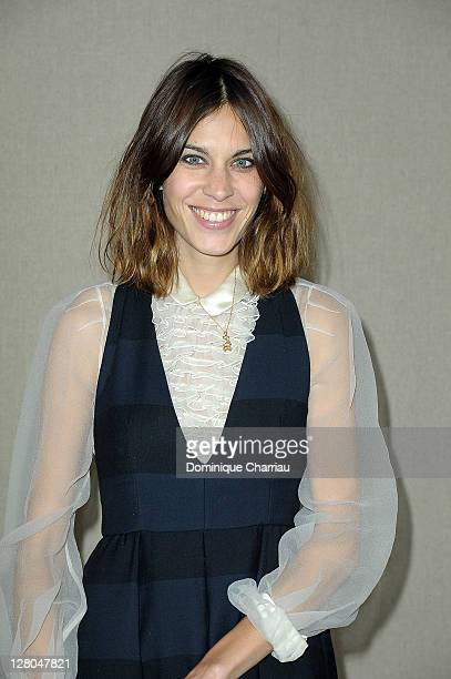 Alexa Chung attends the Miu Miu Ready to Wear Spring / Summer 2012 show during Paris Fashion Week on October 5 2011 in Paris France