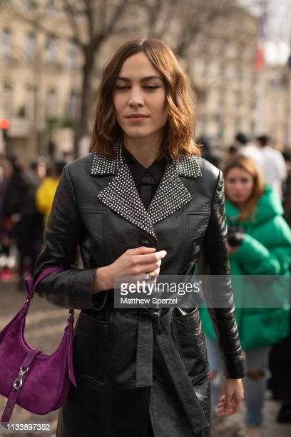 Alexa Chung is seen on the street attending MIU MIU during Paris Fashion Week AW19 wearing MIU MIU on March 05 2019 in Paris France