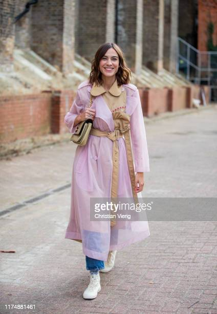 Alexa Chung is seen wearing beige pink two tone trench coat outside Rochas during London Fashion Week September 2019 on September 15, 2019 in London,...