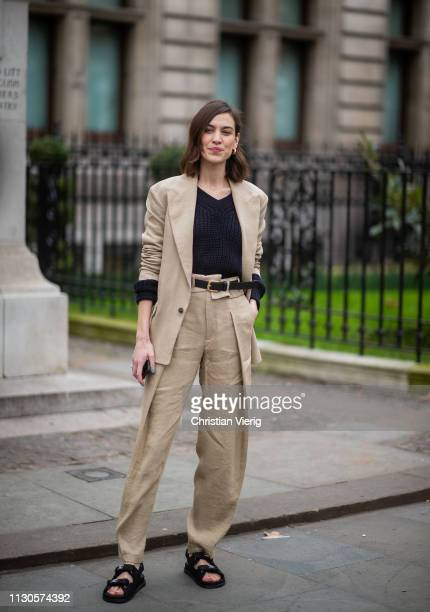 Alexa Chung is seen wearing beige suit, Chanel sandals outside Erdem during London Fashion Week February 2019 on February 18, 2019 in London, England.