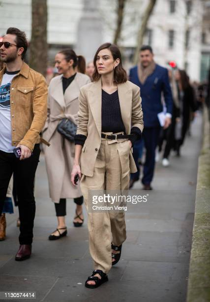 Alexa Chung is seen wearing beige suit Chanel sandals outside Erdem during London Fashion Week February 2019 on February 18 2019 in London England