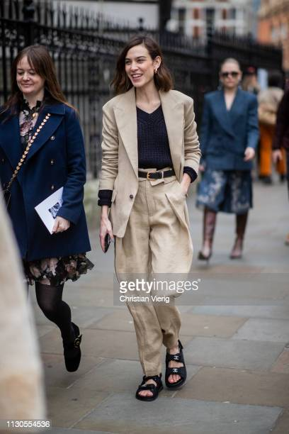 Alexa Chung is seen wearing Chanel sandals, beige suit outside Erdem during London Fashion Week February 2019 on February 18, 2019 in London, England.