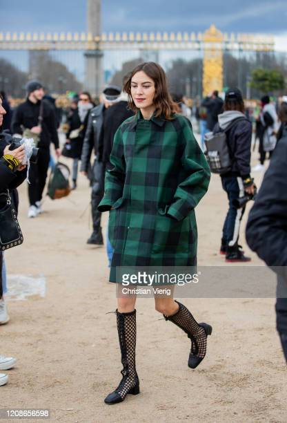 Alexa Chung is seen wearing green checkered coat outside Dior during Paris Fashion Week - Womenswear Fall/Winter 2020/2021 : Day Two on February 25,...