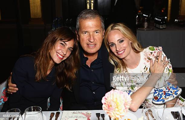 Alexa Chung Mario Testino and cofounder Lauren Santo Domingo attend the Moda Operandi Launch Dinner at the Cafe Royal on September 12 2014 in London...