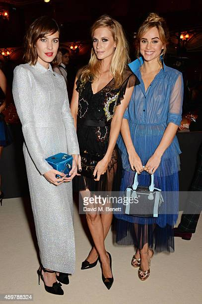 Alexa Chung Poppy Delevingne and Suki Waterhouse attend a drinks reception at the British Fashion Awards at the London Coliseum on December 1 2014 in...