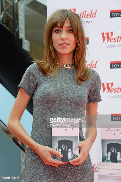 Alexa Chung poses before signing copies of her book 'It' at Westfield London on August 12 2014 in London England