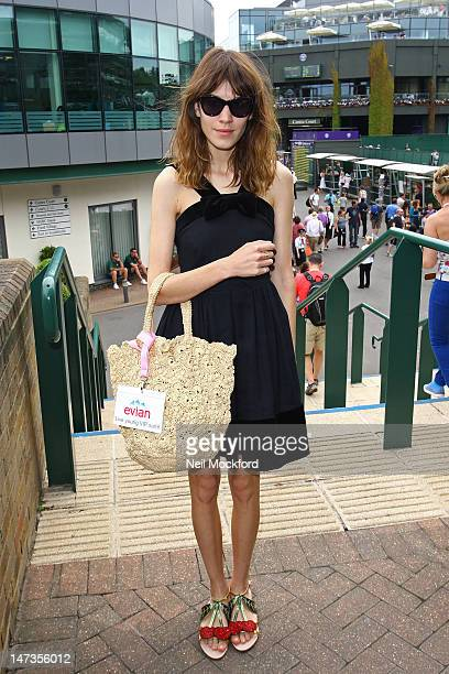 Alexa Chung poses for photos outside the Evian Suite at Wimbledon on June 28 2012 in London England