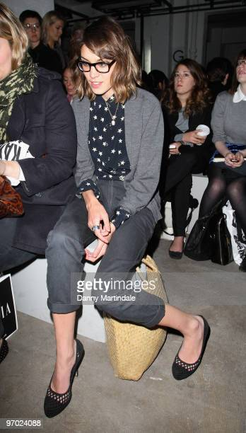 Alexa Chung poses on the front row at the Christopher Kane show for London Fashion Week Autumn/Winter 2010 at TopShop Venue on February 22, 2010 in...